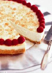 Cheese cake con salsa de frambuesas